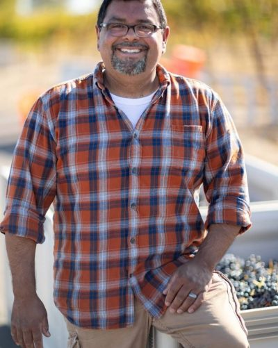 "Cave B Winemaker, Freddy Arredondo has been making wine at Cave B since 2006. Freddy's expertise and excellent palate has helped Cave B Estate Winery garner an impressive number of awards over the years. Prior to becoming a winemaker, Freddy was a professional chef. He started his culinary career at age 13, cooking in his family's restaurant in CA. It was while working and attending culinary classes in Arizona that he was first introduced to wine. At that point in his life wine was a ""mysterious, wonderful elixir"" that he used to complement his dishes.Once Freddy completed culinary school, he worked as a chef in restaurants in Las Vegas, Los Angeles, and on a cruise ship in Hawaii. However, he was drawn to Italy and moved there when he was awarded a scholarship to attend the Italian Culinary Institute for Foreigners. It was in Italy where two life-changing things occurred: he met his future wife Carrie Bryan--daughter of Vince"